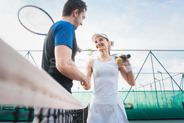 Tennis players shaking hand after match Stock photo © Kzenon