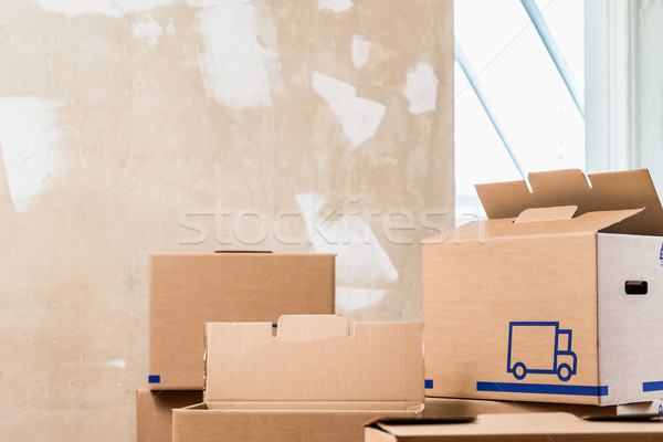 Heap of boxes in the interior of a residential room ready for renovation Stock photo © Kzenon