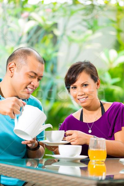азиатских пару кофе домой крыльцо тропические Сток-фото © Kzenon