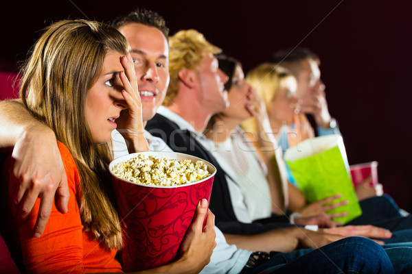 Young people watching movie at movie theater Stock photo © Kzenon