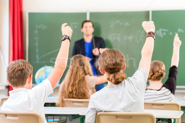Teacher  educate or teaching a class of  pupils in school Stock photo © Kzenon