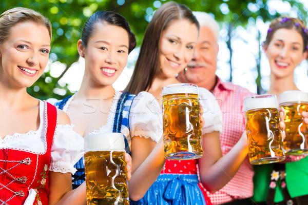 Beer garden - friends drinking in Bavaria Pub Stock photo © Kzenon