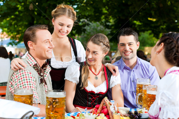 In Beer garden - friends on a table with beer Stock photo © Kzenon