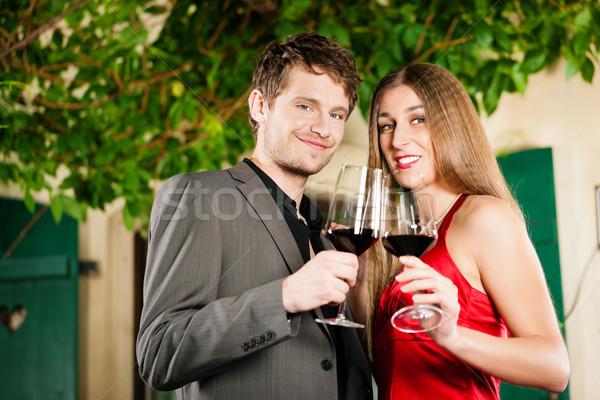 Borkóstolás étterem pár mosoly bor férfi Stock fotó © Kzenon