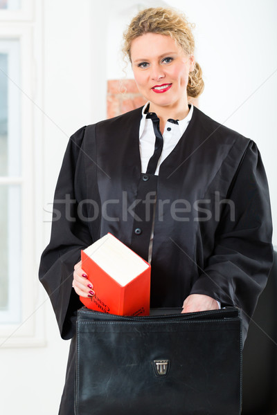 Lawyer in office with law book and case Stock photo © Kzenon