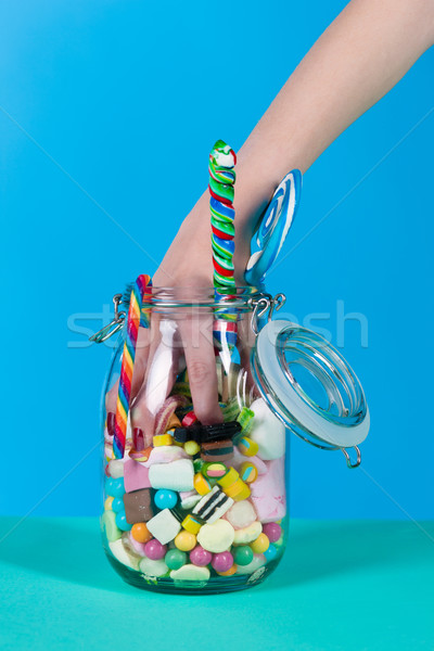 Stock photo: Girl with sweet goodies and candy