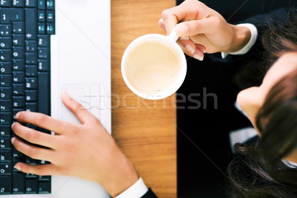 Espresso laptop donna mani faccia Foto d'archivio © Kzenon