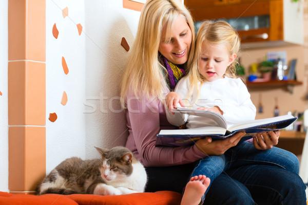 Mother reading night story to kid at home Stock photo © Kzenon