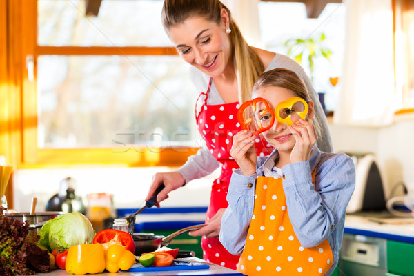 Family cooking healthy food with fun Stock photo © Kzenon
