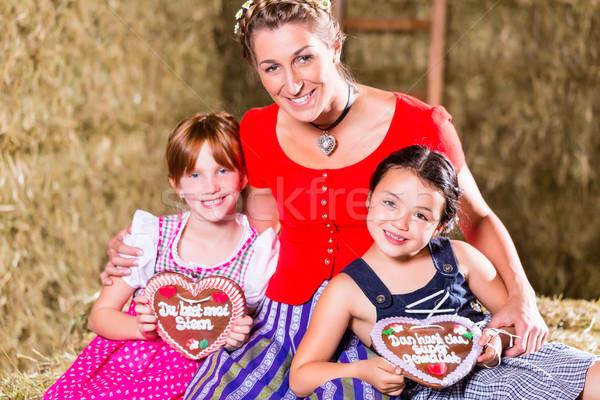 Bavarian family sitting on hayloft with gingerbread Stock photo © Kzenon