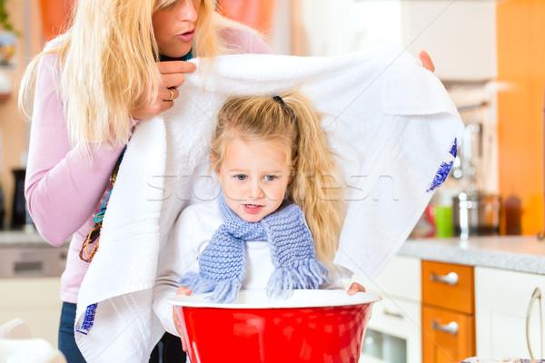 Mother care for sick child with vapor-bath Stock photo © Kzenon