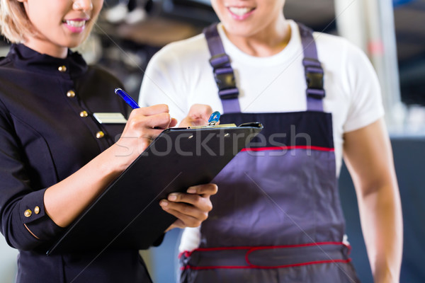 Asian Car mechanic and manager assigning tasks Stock photo © Kzenon