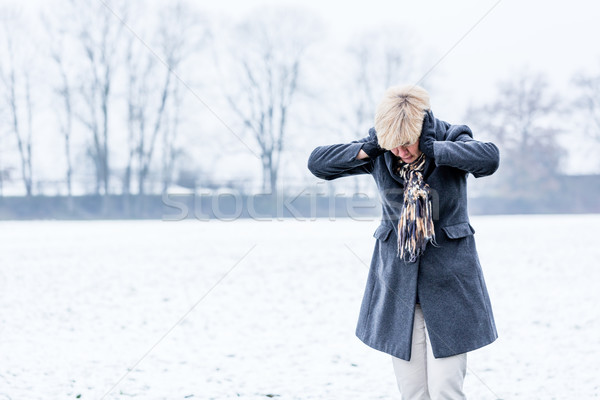 Senior woman with burnout in winter  Stock photo © Kzenon