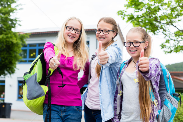 Group of girls standing in front of school Stock photo © Kzenon