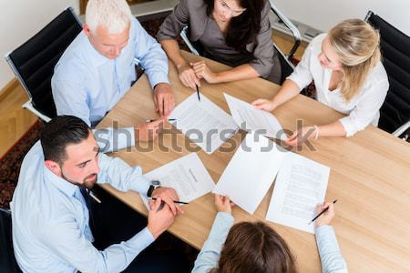 Lawyers in law firm reading documents and agreements Stock photo © Kzenon