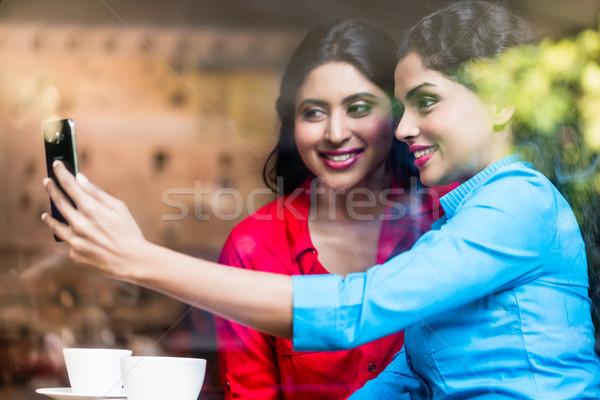 Customers in Indian cafe taking selfie Stock photo © Kzenon
