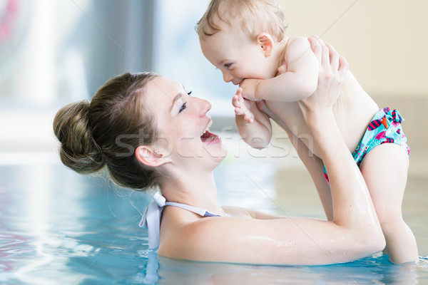 Mother and her newborn child at infant swimming class Stock photo © Kzenon