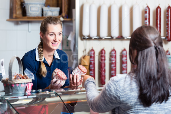 Sales lady in butchery shop serving customer Stock photo © Kzenon