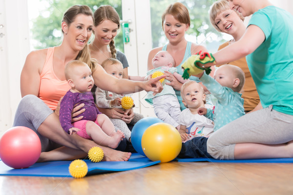 Young women in mother and child group playing with their babies Stock photo © Kzenon