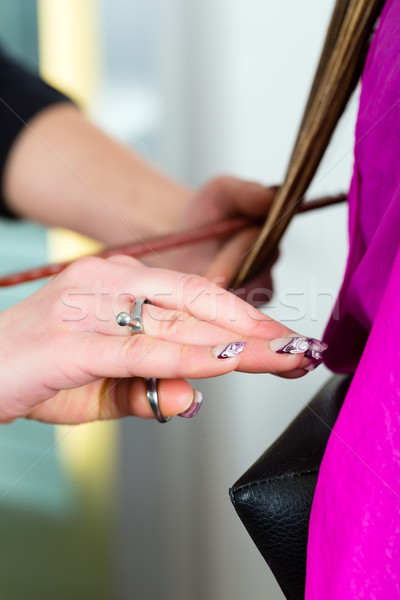 Woman receiving haircut from hairdresser or stylist Stock photo © Kzenon