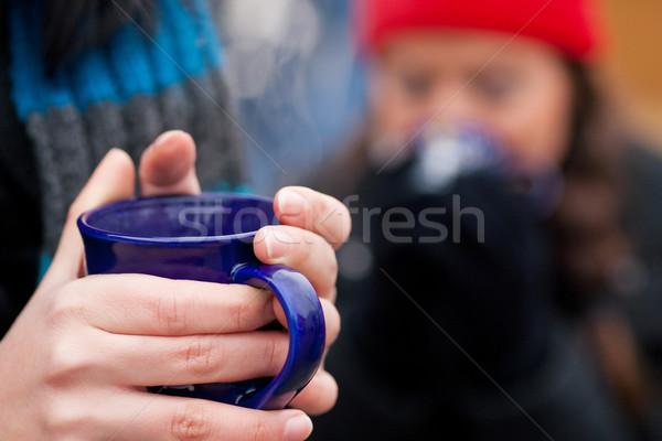 Women on Christmas market drinking punch Stock photo © Kzenon