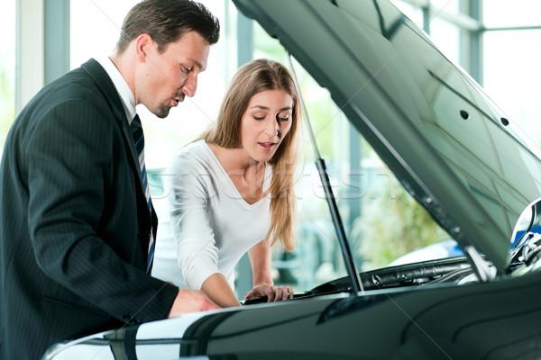 Woman buying car from salesperson Stock photo © Kzenon