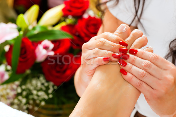 Woman in nail studio receiving foot massage Stock photo © Kzenon