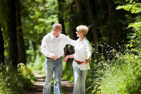 Happy mature couple outdoors Stock photo © Kzenon