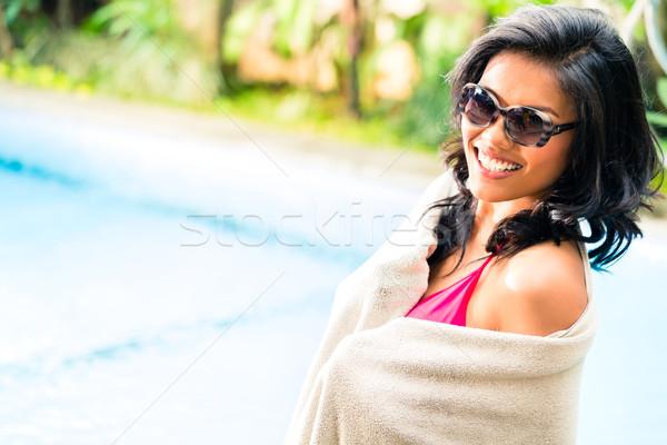 Asian girl at pool Stock photo © Kzenon