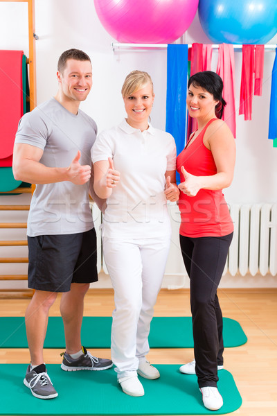 Patients after physical exercises with trainer Stock photo © Kzenon