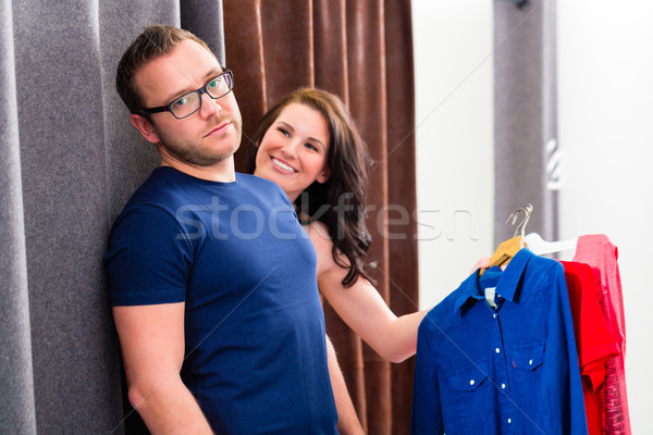 Couple trying clothes in shop changing room Stock photo © Kzenon