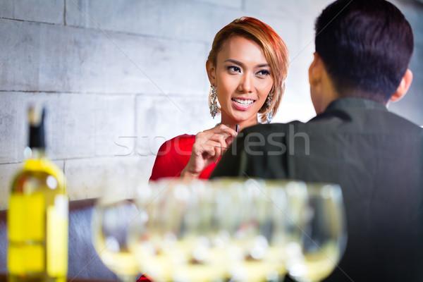 Asian Coppia bere vino bianco bar donna Foto d'archivio © Kzenon
