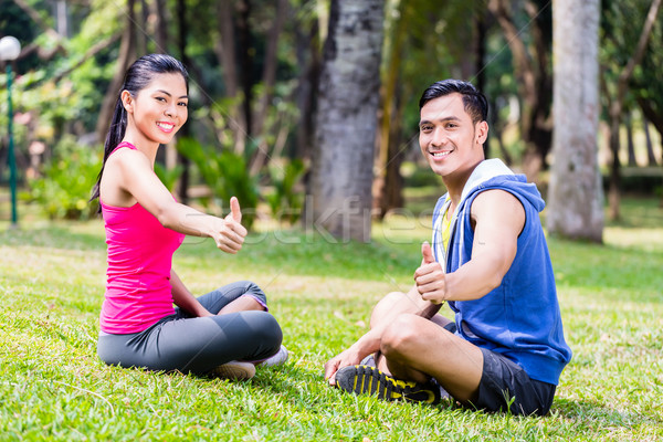 Man and woman at sport gymnastics in park Stock photo © Kzenon