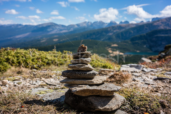 Stone pyramid marking hiking path in the mountains Stock photo © Kzenon
