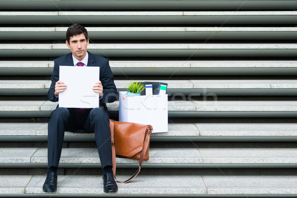 Disconsolate businessman holding a blank sign Stock photo © Kzenon