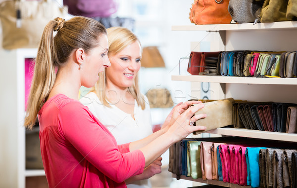 Female customers in store shopping looking for wallets and purse Stock photo © Kzenon