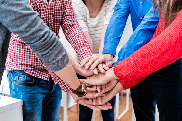 Students in college stacking hand together Stock photo © Kzenon