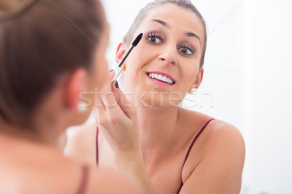 Nő smink szempilla fürdőszoba tükör nők Stock fotó © Kzenon