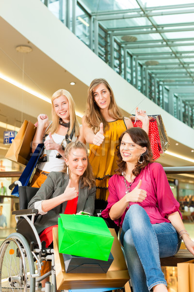 Quatro feminino amigos cadeira de rodas Foto stock © Kzenon