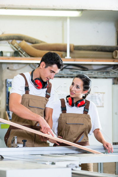 Carpenter and apprentice working together in workshop Stock photo © Kzenon