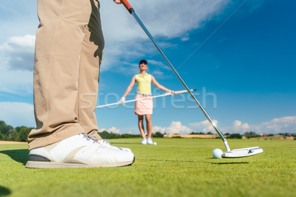 Close-up side view of the feet of a male professional golf player Stock photo © Kzenon