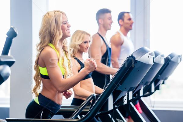 бегущая дорожка группа фитнес спортзал мужчин Сток-фото © Kzenon