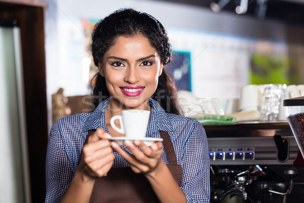 Barista with espresso in Indian cafe Stock photo © Kzenon