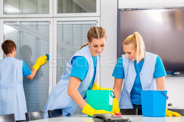 Cleaning brigade working in office Stock photo © Kzenon