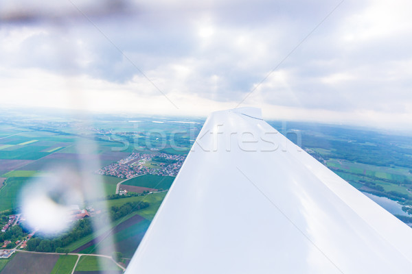 Wing of a flying sport plane Stock photo © Kzenon
