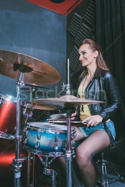 Woman playing the drums in music school Stock photo © Kzenon