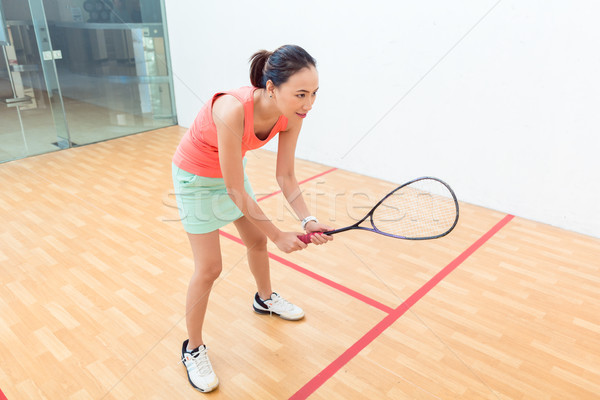 Young squash player holding the racket during game on a professional court Stock photo © Kzenon