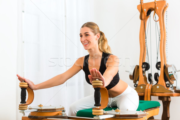 Patient at the physiotherapy making physical exercises Stock photo © Kzenon