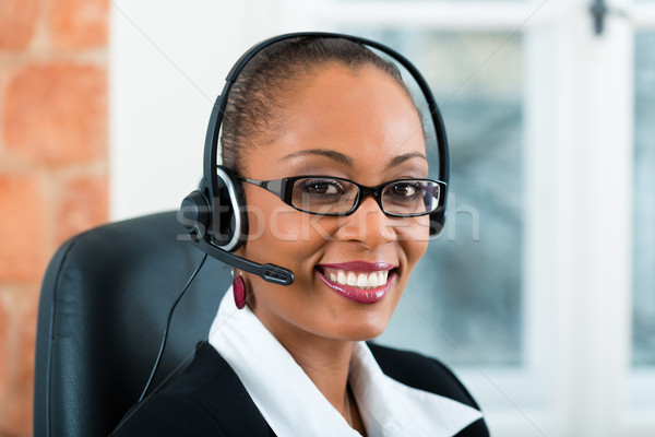 Young Woman from the customer service Stock photo © Kzenon