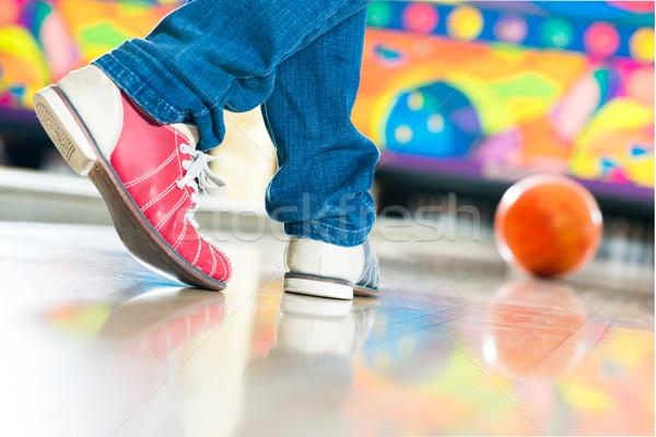 Young man bowling having fun Stock photo © Kzenon